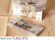 Пачки денег на фоне чертежей. Стоковое фото, фотограф Евгений Кулагин / Фотобанк Лори