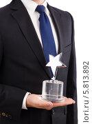 Купить «Бизнесмен с наградным знаком в форме звезды», фото № 5813892, снято 30 октября 2013 г. (c) Elnur / Фотобанк Лори