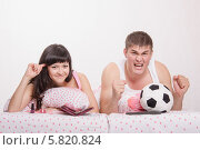 Купить «Муж, по мнению жены, сошел с ума от футбола», фото № 5820824, снято 23 марта 2014 г. (c) Иванов Алексей / Фотобанк Лори