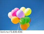 Купить «Связка разноцветных воздушных шаров на фоне голубого неба», фото № 5830436, снято 4 августа 2013 г. (c) Syda Productions / Фотобанк Лори