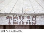 """Купить «Надпись """"Texas"""" на деревянных досках пола», фото № 5882300, снято 13 апреля 2014 г. (c) Кекяляйнен Андрей / Фотобанк Лори"""
