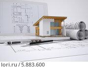 Купить «Ноутбук с моделью здания и чертежи», иллюстрация № 5883600 (c) Кирилл Черезов / Фотобанк Лори