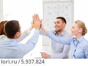 Купить «Счастливые члены бизнес-команды соединили ладони вместе», фото № 5937824, снято 5 апреля 2014 г. (c) Syda Productions / Фотобанк Лори