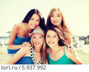 Купить «Летний отдых. Девушки позируют на пляже», фото № 5937992, снято 4 июля 2013 г. (c) Syda Productions / Фотобанк Лори