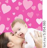 Купить «Мама целует счастливого малыша на фоне из розовых сердечек», фото № 5954980, снято 22 декабря 2007 г. (c) Syda Productions / Фотобанк Лори