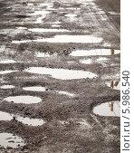 Купить «Лужи в ямах на проселочной дороге», фото № 5986540, снято 7 июня 2014 г. (c) EugeneSergeev / Фотобанк Лори