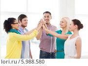 Купить «Успешная бизнес-команда молодых людей стоит, сложив руки ладонями вместе», фото № 5988580, снято 17 мая 2014 г. (c) Syda Productions / Фотобанк Лори