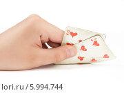 Купить «Две игральные карты в руке на белом фоне», фото № 5994744, снято 25 февраля 2020 г. (c) safonovstudio / Фотобанк Лори