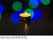 Купить «Чайная свеча горит на столе», фото № 6018572, снято 27 января 2014 г. (c) Anton Kozyrev / Фотобанк Лори