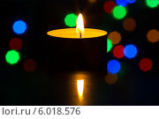 Купить «Горящая чайная свеча в темноте», фото № 6018576, снято 27 января 2014 г. (c) Anton Kozyrev / Фотобанк Лори
