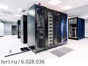Купить «Оборудование в серверной комнате дата-центра», фото № 6028036, снято 14 мая 2014 г. (c) Alexander Tihonovs / Фотобанк Лори