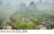 Купить «Карстовые холмы, Китай, таймлапс», видеоролик № 6032304, снято 20 июня 2014 г. (c) Кирилл Трифонов / Фотобанк Лори