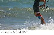 Купить «Кайтсерфер в море», видеоролик № 6034316, снято 11 июня 2014 г. (c) Игорь Жоров / Фотобанк Лори