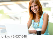 Smiling student girl with laptop at college. Стоковое фото, фотограф CandyBox Images / Фотобанк Лори