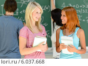 Two college student friends talking math lesson. Стоковое фото, фотограф CandyBox Images / Фотобанк Лори