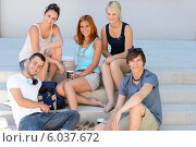 Students group sitting on school stairs smiling. Стоковое фото, фотограф CandyBox Images / Фотобанк Лори