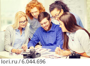 Купить «smiling team with photocamera and images in office», фото № 6044696, снято 1 февраля 2014 г. (c) Syda Productions / Фотобанк Лори
