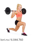 Купить «smiling sporty woman exercising with barbell», фото № 6044760, снято 8 мая 2014 г. (c) Syda Productions / Фотобанк Лори