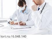 Купить «doctor and nurse writing prescription paper», фото № 6048140, снято 10 апреля 2013 г. (c) Syda Productions / Фотобанк Лори