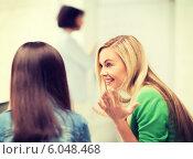 Купить «student girl gossiping in lecture at school», фото № 6048468, снято 16 июня 2013 г. (c) Syda Productions / Фотобанк Лори