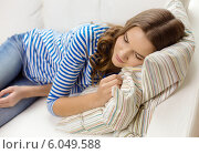 Купить «smiling teenage girl sleeping on sofa at home», фото № 6049588, снято 26 февраля 2014 г. (c) Syda Productions / Фотобанк Лори