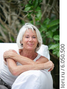 Купить «An elderly woman relaxing outside», фото № 6050500, снято 13 марта 2009 г. (c) Phovoir Images / Фотобанк Лори