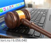 Купить «Online internet auction. Gavel on laptop.», фото № 6056040, снято 24 октября 2018 г. (c) Maksym Yemelyanov / Фотобанк Лори