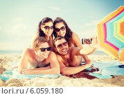 group of people taking picture with smartphone. Стоковое фото, фотограф Syda Productions / Фотобанк Лори
