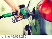 Купить «man pumping gasoline fuel in car at gas station», фото № 6059280, снято 26 июня 2013 г. (c) Syda Productions / Фотобанк Лори