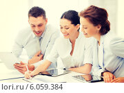 Купить «business team working with tablet pcs», фото № 6059384, снято 9 июня 2013 г. (c) Syda Productions / Фотобанк Лори