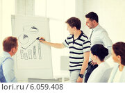 Купить «business team working with flipchart in office», фото № 6059408, снято 9 июня 2013 г. (c) Syda Productions / Фотобанк Лори