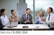 Купить «Business people applauding on meeting», видеоролик № 6060364, снято 12 ноября 2013 г. (c) Syda Productions / Фотобанк Лори