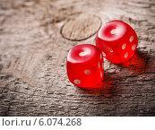 Купить «Pair of thrown red dices on old wooden table», фото № 6074268, снято 10 марта 2014 г. (c) Майя Крученкова / Фотобанк Лори