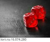 Купить «Pair of thrown red dices on black background», фото № 6074280, снято 10 марта 2014 г. (c) Майя Крученкова / Фотобанк Лори