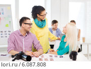 Купить «smiling team with printed photos working in office», фото № 6087808, снято 17 мая 2014 г. (c) Syda Productions / Фотобанк Лори