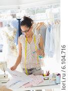 Купить «Female fashion designer working on her designs», фото № 6104716, снято 5 ноября 2013 г. (c) Wavebreak Media / Фотобанк Лори