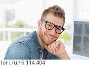 Купить «Handsome designer smiling at camera at his desk», фото № 6114404, снято 4 ноября 2013 г. (c) Wavebreak Media / Фотобанк Лори