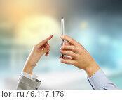 Купить «Using mobile phone», фото № 6117176, снято 12 декабря 2012 г. (c) Sergey Nivens / Фотобанк Лори