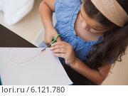 Купить «High angle close-up of a girl cutting chart paper», фото № 6121780, снято 11 ноября 2013 г. (c) Wavebreak Media / Фотобанк Лори