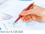 Купить «Analyzing report», фото № 6125024, снято 15 января 2014 г. (c) Sergey Nivens / Фотобанк Лори