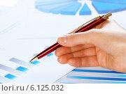 Купить «Analyzing report», фото № 6125032, снято 15 января 2014 г. (c) Sergey Nivens / Фотобанк Лори