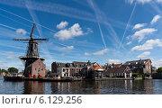 Купить «Ветряная мельница в Харлеме, Нидерланды», фото № 6129256, снято 3 сентября 2013 г. (c) Евгений Прокофьев / Фотобанк Лори