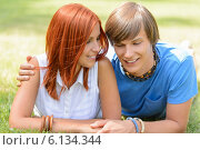 Купить «Teenage boyfriend and girlfriend lying on grass», фото № 6134344, снято 19 июня 2014 г. (c) CandyBox Images / Фотобанк Лори