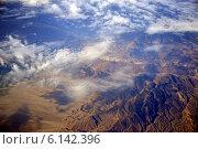 Облака и горы с высоты 10000 метров (2014 год). Стоковое фото, фотограф Григорий Карамянц / Фотобанк Лори