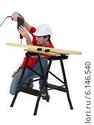 Купить «Handyman drilling a piece of wood.», фото № 6146540, снято 1 марта 2011 г. (c) Phovoir Images / Фотобанк Лори