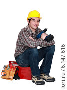 Купить «Young worker with a drill», фото № 6147616, снято 1 апреля 2011 г. (c) Phovoir Images / Фотобанк Лори
