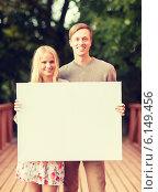 Купить «romantic couple with blank white board», фото № 6149456, снято 6 сентября 2013 г. (c) Syda Productions / Фотобанк Лори