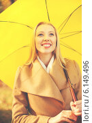 Купить «woman with yellow umbrella in the autumn park», фото № 6149496, снято 5 октября 2013 г. (c) Syda Productions / Фотобанк Лори