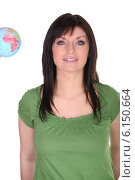 Купить «Woman stood with small globe», фото № 6150664, снято 30 марта 2010 г. (c) Phovoir Images / Фотобанк Лори