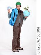 Купить «Construction worker holding a globe», фото № 6150904, снято 7 января 2011 г. (c) Phovoir Images / Фотобанк Лори